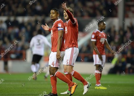 Michael Mancienne and Matthew Mills of Nottingham Forest protest to the linesman after conceding the first goal during the Sky Bet Championship match at the City Ground, Nottingham