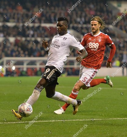 Sheyi Ojo of Fulham and Matthew Mills of Nottingham Forest during the Sky Bet Championship match at the City Ground, Nottingham