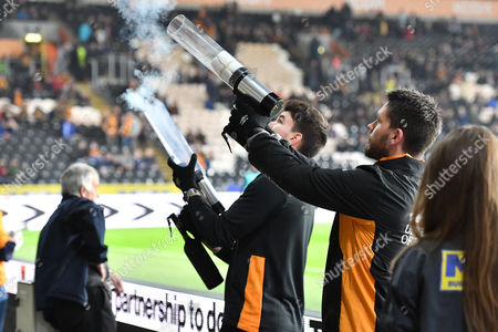 Hull City staff launch Dean Windass t shirts into the crowd before  the EFL Sky Bet Championship match between Hull City and Preston North End at the KCOM Stadium, Kingston upon Hull