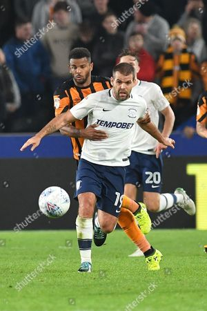 Hull City forward Fraizer Campbell (25) and Preston North End midfielder John Welsh (19) during the EFL Sky Bet Championship match between Hull City and Preston North End at the KCOM Stadium, Kingston upon Hull