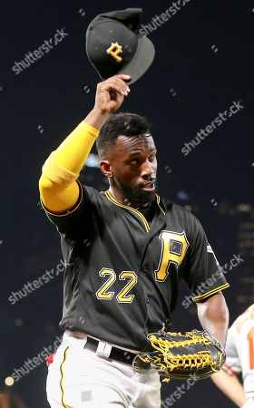 Stock Image of Andrew McCutchen. Pittsburgh Pirates hitting coach Jeff Branson doffs his cap to the crowd as they cheer when he was lifted in the seventh inning of the baseball game, in Pittsburgh. The Pirates won 10-1 as McCutchen hit two home runs, a double, and a singe driving in eight runs