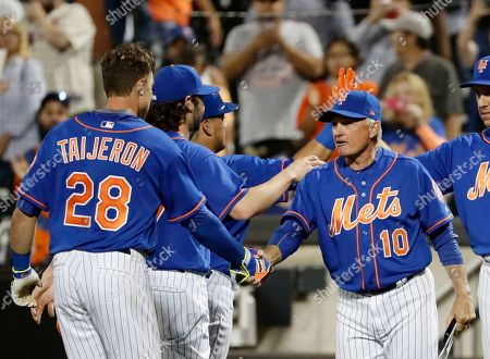 Travis Taijeron, Terry Collins. New York Mets manager Terry Collins (10) shakes hands with Travis Taijeron (28) after Taijeron drove in the winning run during the ninth inning of a baseball game against the Atlanta Braves, in New York. The Mets won 4-3