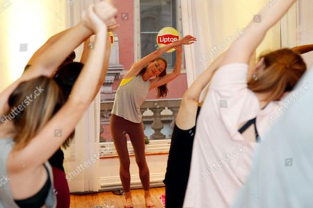 "Stock Photo of Tara Stiles, founder and owner of Strala Yoga, leads a special ""De-Stress Flow"" yoga class to celebrate the launch of the new Lipton Wellness range on in New York. For more information on the new Lipton Wellness range, Strala Yoga and Tara Stiles' curated tips for living a happy, healthy and radiant life, please visit www.LiptonTea.com"