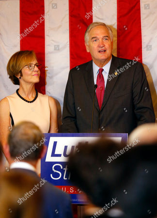 Senator Luther Strange speaks to supporters with his wife Melissa as he concedes the election to Judge Roy Moore, in Homewood, Ala
