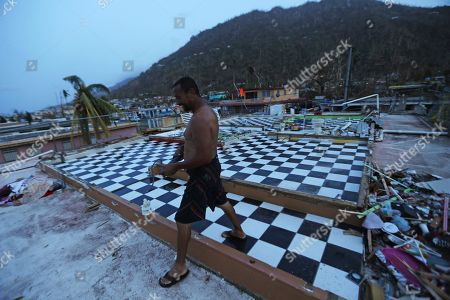 Stock Photo of Nestor Serrano walks on the upstairs floor of his home, where the walls were blown off, in the aftermath of Hurricane Maria in Yabucoa, Puerto Rico