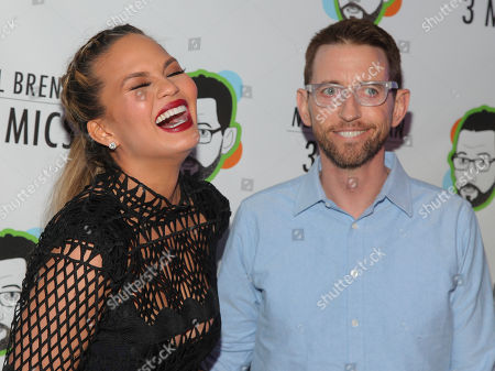 "Chrissy Teigen, left, and Neal Brennan, right, attend the Broadway opening night party of ""Neal Brennan 3 MICS"" at The Lynn Redgrave Theater, in New York"