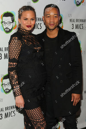 "Chrissy Teigen, left, and John Legend, right, attend the Broadway opening night party of ""Neal Brennan 3 MICS"" at The Lynn Redgrave Theater, in New York"