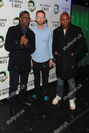 "Chris Rock, from left, Neal Brennan and Dave Chappelle attend the Broadway opening night party of ""Neal Brennan 3 MICS"" at The Lynn Redgrave Theater, in New York"