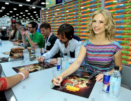 """From left, producers David Zuckerman, Eli Jorne, Reed Agnew, and cast members Jason Gann, Fiona Gubelmann and Dorian Brown sign autographs at the FX """"Wilfred"""" booth signing on Day 2 of Comic-Con International on in San Diego, Calif"""