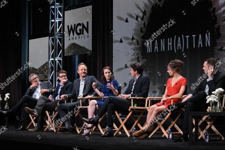 """Director/executive producer Thomas Schlamme, from left, creator/writer/executive producer Sam Shaw, actors John Benjamin Hickey, Rachel Brosnahan, Ashley Zukerman, Katja Herbers and Christopher Denham speak onstage during the """"Manhattan"""" panel at the Viacom Networks 2015 Summer TCA Tour held at the Beverly Hilton Hotel on in Beverly Hills, Calif"""