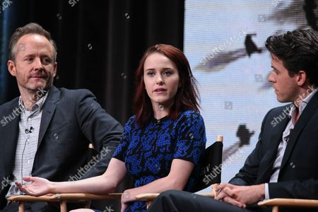 """John Benjamin Hickey, from left, Rachel Brosnahan, and Ashley Zukerman speak onstage during the """"Manhattan"""" panel at the Viacom Networks 2015 Summer TCA Tour held at the Beverly Hilton Hotel on in Beverly Hills, Calif"""