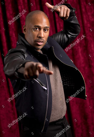 """DJ/Producer Ali Shaheed Muhammad of hip-hop group A Tribe Called Quest poses for a photo at SiriusXM studios in New York. A Tribe Called Quest celebrated the 25th anniversary of its debut album, """"People's Instinctive Travels and the Paths of Rhythm,"""" in November by re-releasing the album with remixes helmed by Pharrell, CeeLo Green and J. Cole. The group said more re-releases will be issues for its other albums"""