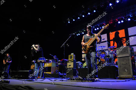 """JULY 18: Chan Kinchla.John Popper, Brendan Hill and Tad Kinchla of Blues Traveler performs during the """"Last Summer on Earth Tour 2012"""" at the Cruzan Amphitheater on in West Palm Beach, Florida"""