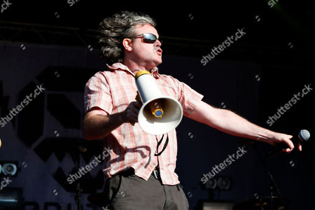 Stock Photo of British singer Graham Crabb of the band Pop Will Eat Itself performs at Camp Bestival at Lulworth Castle, in Dorset, England. Thousands of music fans have arrived to the festival to see headliners James, De La Soul and Basement Jaxx