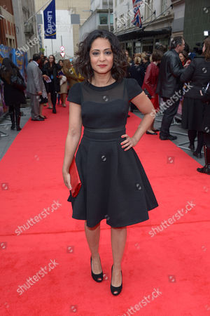 Parminder Nagra poses for photographers on the red carpet for Postman Pat World Premiere on