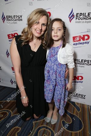 Dr. Erin Kiehna with 7 year old Mila Mullenix seen at the Epilepsy Foundation of Greater Los Angeles Care and Cure benefit honoring Patrick Whitesell, WME | IMG Co-CEO, in Beverly Hills, CA