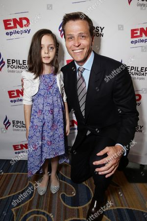 7 year old Mila Mullenix and Patrick Whitesell, WME | IMG Co-CEO seen at the Epilepsy Foundation of Greater Los Angeles Care and Cure benefit honoring Patrick Whitesell, WME | IMG Co-CEO, in Beverly Hills, CA