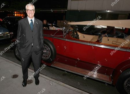 Stock Picture of Hennessy Global Brand Ambassador and 8th generation family member Maurice Hennessy poses in front of 1929 Rolls-Royce Ascot at Hennessy X.O dinner on at The Baccarat Hotel in New York City. The private dinner featured casual conversation that shed light on pioneering brands' Hennessy Cognac and Rolls-Royce and how they've helped shape the trajectory of luxury goods