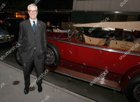 Stock Photo of Hennessy Global Brand Ambassador and 8th generation family member Maurice Hennessy poses in front of 1929 Rolls-Royce Ascot at Hennessy X.O dinner on at The Baccarat Hotel in New York City. The private dinner featured casual conversation that shed light on pioneering brands' Hennessy Cognac and Rolls-Royce and how they've helped shape the trajectory of luxury goods