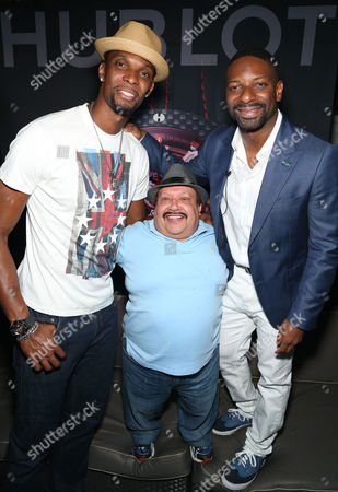 Chris Bosh, of the Miami Heat, Chuy Bravo and DJ Irie arrive at HUBLOT's VIP Kickoff reception for the 10th Annual Irie Weekend on Thursday, June, 19, 2014 at the National Hotel in Miami Beach, Fl