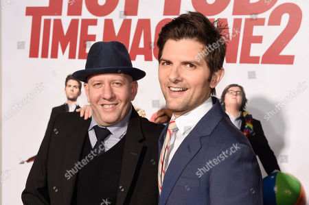"Steve Pink, left, director of ""Hot Tub Time Machine 2,"" poses with cast member Adam Scott at the premiere of the film at the Regency Village Theater, in Los Angeles"