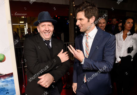 "Steve Pink, left, director of ""Hot Tub Time Machine 2,"" mingles with cast member Adam Scott at the premiere of the film at the Regency Village Theater, in Los Angeles"