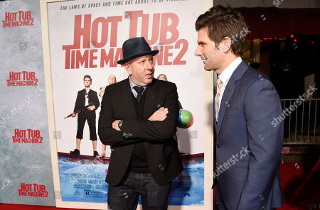 "Stock Picture of Steve Pink, left, director of ""Hot Tub Time Machine 2,"" mingles with cast member Adam Scott at the premiere of the film at the Regency Village Theater, in Los Angeles"