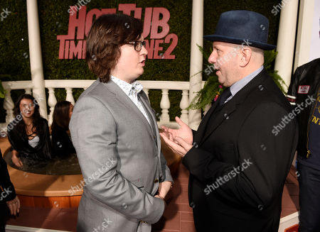 "Clark Duke, left, a cast member in ""Hot Tub Time Machine 2,"" mingles with director Steve Pink at the premiere of the film at the Regency Village Theater, in Los Angeles"