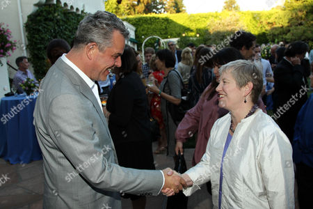 """Stock Photo of Danny Huston, left, greets Consul General Dame Barbara Hay at STARZ' """"The White Queen"""" cocktail event at the British Consulate on in Los Angeles. """"The White Queen"""" premieres Saturday, Aug. 10 on STARZ"""