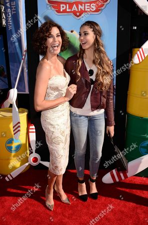 """Actress Teri Hatcher, right, and her daughter Emerson Hatcher arrive on the red carpet of the world premiere of Disney's """"Planes"""" at the El Capitan Theatre, in Los Angeles"""