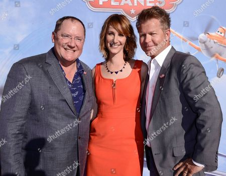"""Stock Photo of John Lasseter, Chief Creative Officer at Walt Disney and Pixar Animation Studios, left, producer Traci Balthazor-Flynn, center, and director Klay Hall arrive on the red carpet of the world premiere of Disney's """"Planes"""" at the El Capitan Theatre, in Los Angeles"""