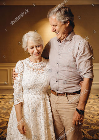 "Helen Mirren and Lasse Halstrom embrace during press day for ""The Hundred Year Journey"" at The Four Seasons, in Beverly Hills, Calif"