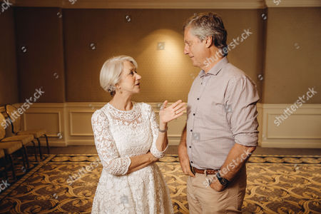 "Helen Mirren and Lasse Halstrom sharing conversation during press day for ""The Hundred Year Journey"" at The Four Seasons, in Beverly Hills, Calif"