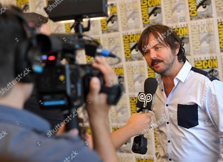 """Jason Gann, right, participates in an interview at the FX """"Wilfred"""" press room on Day 2 of Comic-Con International on in San Diego, Calif"""