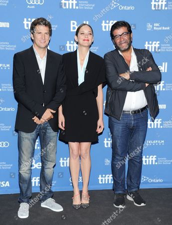 """Director Guillaume Canet, actress Marion Cotillard and producer Alain Attal attend the press conference for """"Blood Ties"""" on day 6 of the 2013 Toronto International Film Festival at the TIFF Bell Lightbox on in Toronto"""