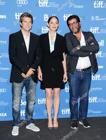 """Director Guillaume Canet, from left, actress Marion Cotillard and producer Alain Attal attend the press conference for """"Blood Ties"""" on day 6 of the 2013 Toronto International Film Festival at the TIFF Bell Lightbox on in Toronto"""
