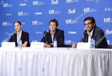 """Director Guillaume Canet, center, actress Marion Cotillard, left, and producer Alain Attal participate in the press conference for """"Blood Ties"""" on day 6 of the 2013 Toronto International Film Festival at the TIFF Bell Lightbox on in Toronto"""