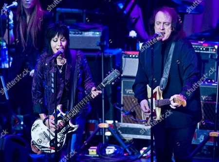 Joan Jett, left, performs with Tommy James at the 6th Annual Little Kids Rock benefit presented by Guitar Center at the Hammerstein Ballroom on in New York