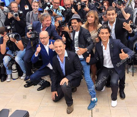 From left, actors Fatsah Bouyahmed, director Mohamed Hamidi, actors Jemal Debbouze, Julie De Bona, Malik Bantalha and Tewfik Jallab during a photo call for the film Born Somewhere at the 66th international film festival, in Cannes, southern France