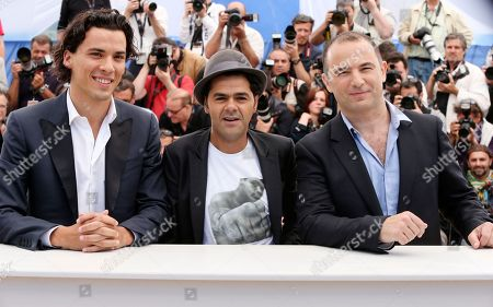 From left, actors Tewfik Jallab, Jemal Debbouze and director Mohamed Hamidi pose for photographers during a photo call for the film Born Somewhere at the 66th international film festival, in Cannes, southern France