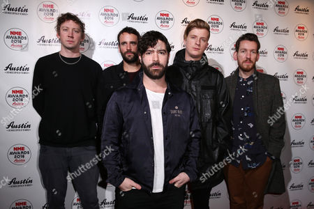 Edwin Congreave, Jack Bevan, Jimmy Smith, Yannis Philippakis and Walter Gervers of the music band Foals pose for photographers upon arrival at the NME 2016 music awards in London