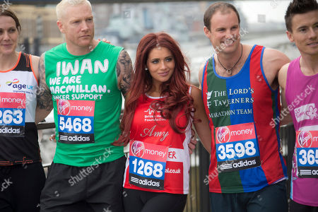 From left to right, Kelly Sotherton, Iwan Thomas, Amy Childs, Andrew Strauss, and James Toseland, pose for photographs at Tower Bridge, ahead of the Virgin London Marathon