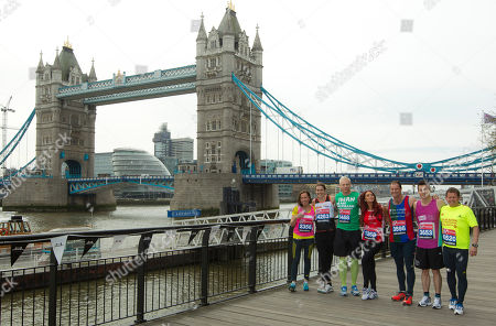 Celebrity London Marathon entrants include, from left, Andrew Strauss, Amy Childs, Mike Bushell, James Toseland, Kelly Sotherton, James Argent, Allen Leech, Amanda Mealing, Iwan Thomas, as they pose for photographs at Tower Bridge, in background, ahead of the upcoming Virgin London Marathon