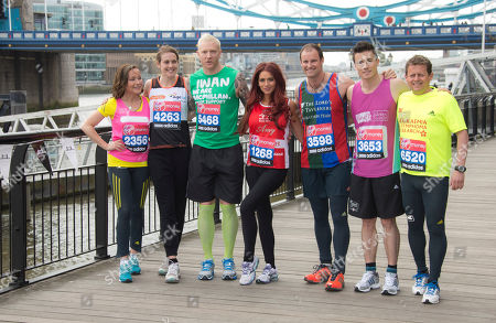 Amanda Mealing, from left to right, Kelly Sotherton, Iwan Thomas, Amy Childs, Andrew Strauss, James Toseland, and Mike Bushell, pose for photographs at Tower Bridge, ahead of the Virgin London Marathon