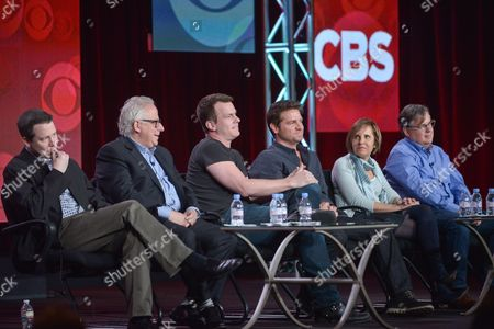 """From left, Rob Doherty, Gary Glasberg, Jonathan Nolan, Greg Plageman, Michelle King, and Robert King participate in the """"Drama Showrunners"""" panel at the CBS Winter 2014 TCA Press Tour, Wed, in Pasadena, Calif"""