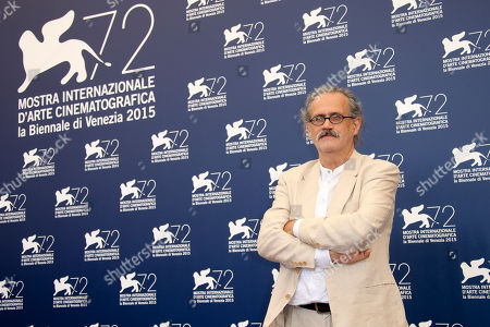 Director Giuseppe Gaudino poses during the photo call for the movie Per Amore Vostro (For your Love) at the 72nd edition of the Venice Film Festival in Venice, Italy, . The 72nd edition of the festival runs until Sept. 12