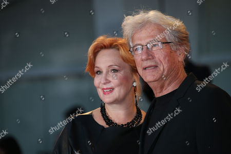 Jurgen Prochnow and wife Verena Wengler pose for photographers upon arrival for the film, Remember, at the 72nd edition of the Venice Film Festival in Venice, Italy, . The 72nd edition of the festival runs until Sept. 12