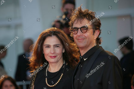 Director Atom Egoyan and Arsinee Khanjian pose for photographers upon arrival for the film, Remember, at the 72nd edition of the Venice Film Festival in Venice, Italy, . The 72nd edition of the festival runs until Sept. 12