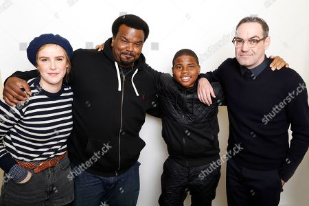 "Actors, from left, Carla Juri, Craig Robinson, and Markees Christmas pose with filmmaker Chad Hartigan to promote their film, ""Morris From America"", during the Sundance Film Festival in Park City, Utah. The film is a coming-of-age dramedy about an American teen and his single father who relocate to a small town in Germany"