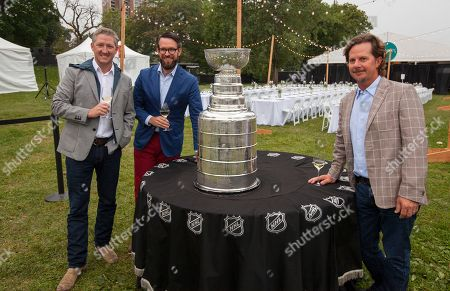 Tim Love, Danny Wirtz and Charlie Jones with the Stanley Cup at the Feast Under the Stars event during the Chicago Food + Wine Festival, in Chicago